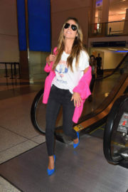 Heidi Klum wears Black Jeans & Blue Belly at LAX Airport in Los Angeles