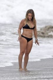 Hilary Duff wears tiny black bikini at a beach in Malibu
