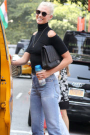 Karlie Kloss wears high neck top and jeans Out in New York