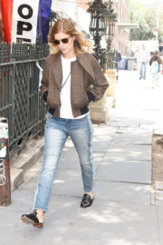 Kate Mara wears white top & blue jeans out in New York