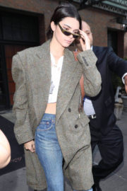 Kendall Jenner flashes belly button out and about in New York