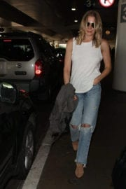 LeAnn Rimes wears Sleveless Top and Ripped Jeans at LAX Airport in Los Angeles