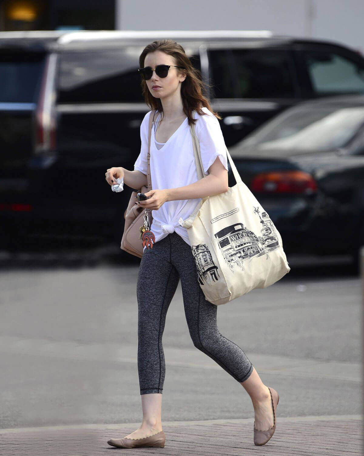 Lily Collins wears White Top & Tights Bottom Out in Los Angeles