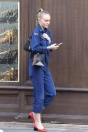Lily-Rose Depp wears blue boiler suit during shopping in Paris