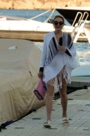 Lindsay Lohan shows off legs Leaves a Yacht in Mykonos