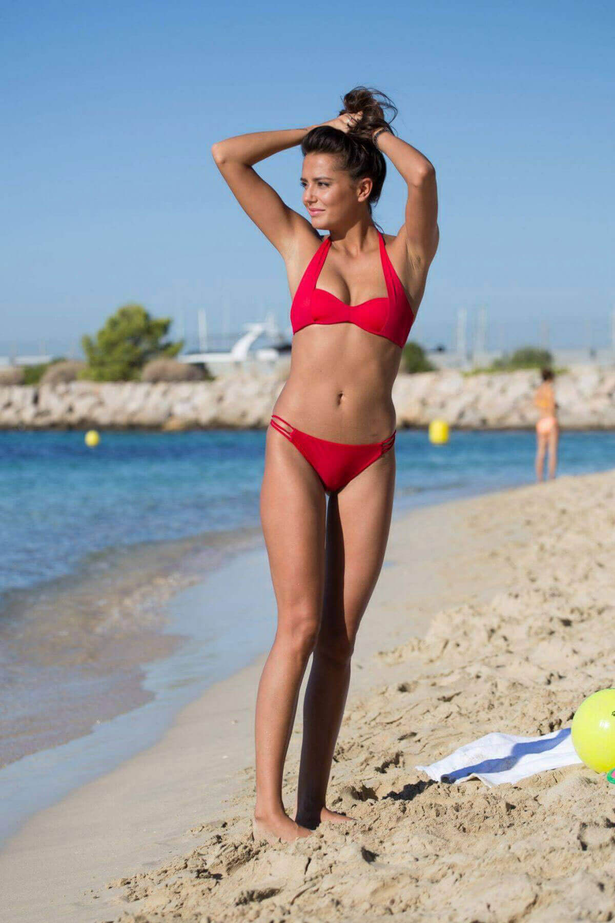 Love Island's Tyla Carr flashes her abs in red bikini at a beach in Mallorca
