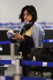 Lucy Hale wears Yellow Striped Top at Airport in Vancouver