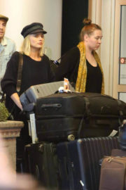 Margot Robbie Arrives with Luggage at Toronto International Airport