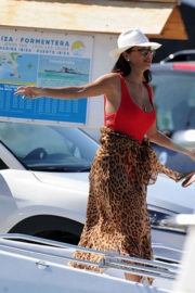 Nicole Scherzinger shows off her cleavage in racy red swimsuit at a boat in Ibiza