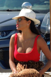 Nicole Scherzinger shows off her cleavage in red swimsuit at a boat in Ibiza