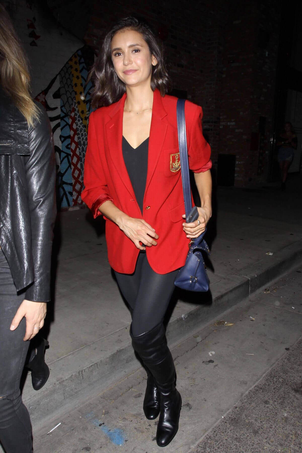 Nina Dobrev stills red blazer for night at highlight room in Los Angeles