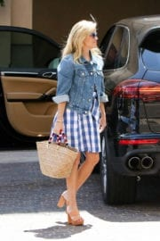 Reese Witherspoon wears short blue checked skirt out in Los Angeles