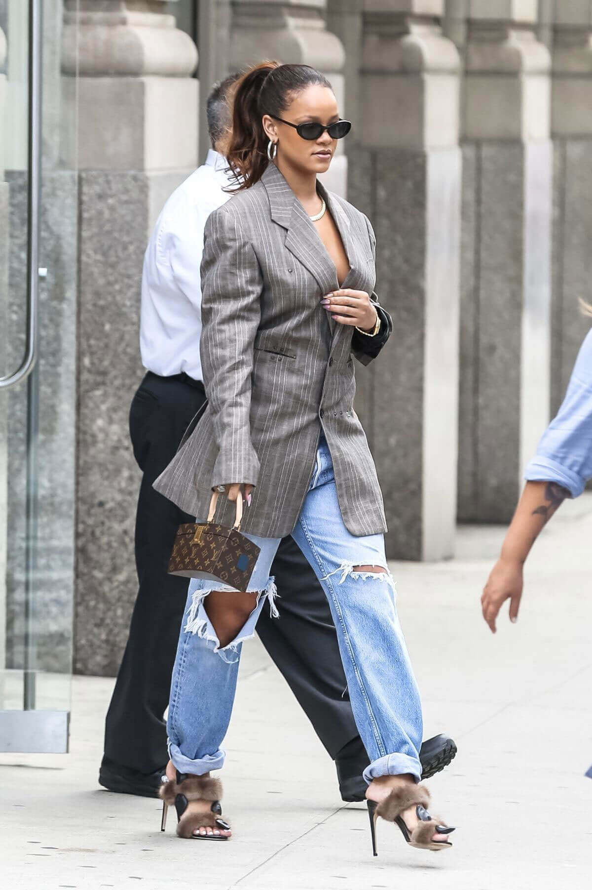 Rihanna without Bra wears Suit Heading to New York Fashion Week in New York