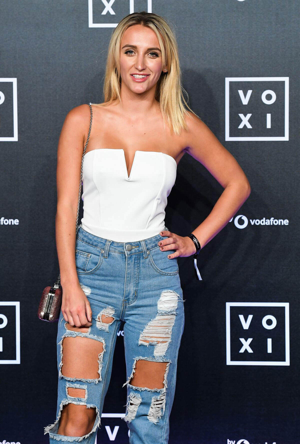 Tiffany Watson wears ripped jeans at Voxi Launch Party in London