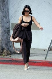 Vanessa Hudgens wears pinstripe pants and about in Los Angeles