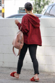 Vanessa Hudgens wears Red Jacket & Black Jeans Out and About in Los Angeles