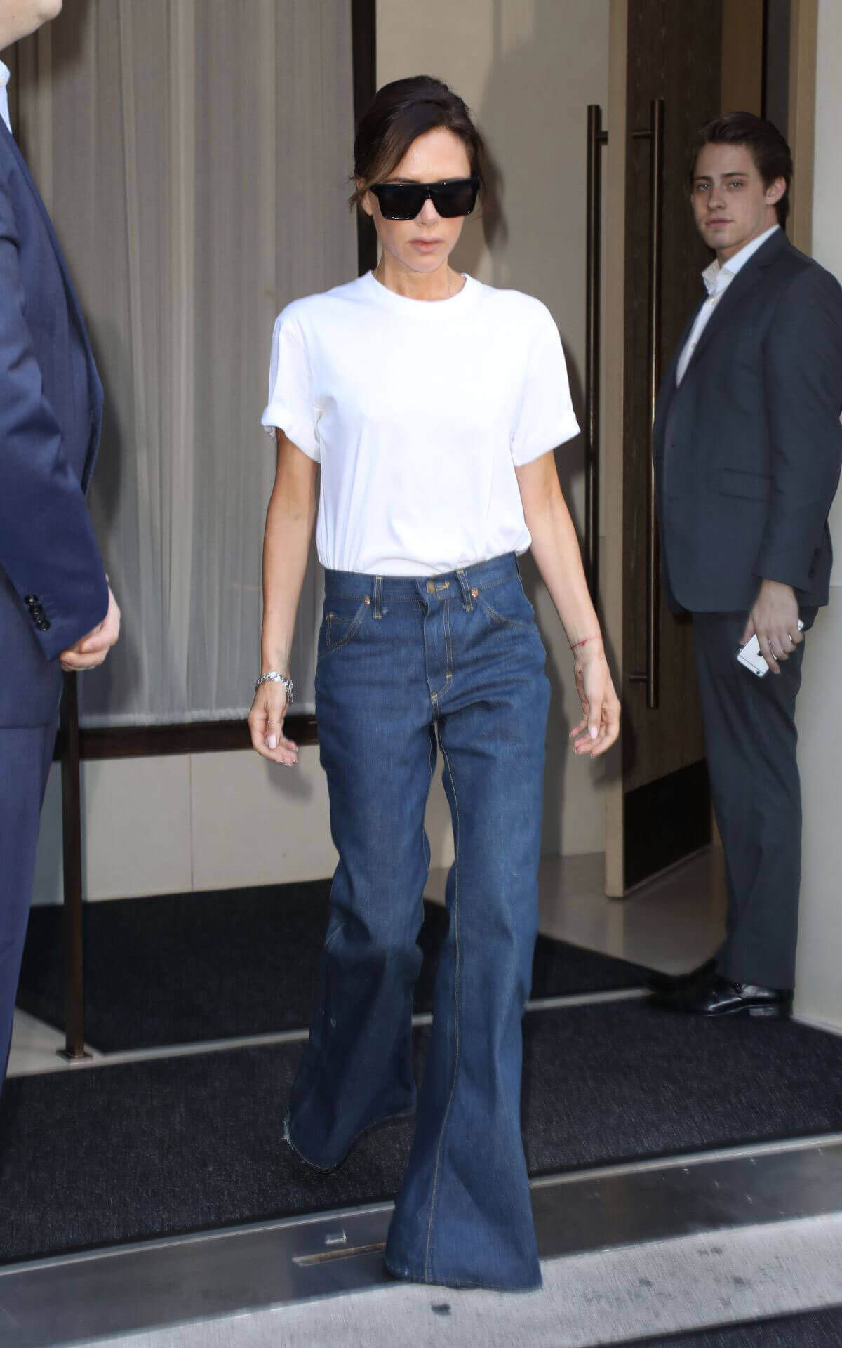 Victoria Beckham wears Flared Jeans Leaves Edition Hotel in New York