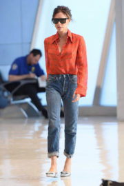 Victoria Beckham wears Floral Shirt Arrives at JFK Airport in New York
