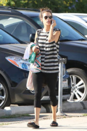 Alessandra Ambrosio wears Stripped Top & Tights Bottom Out and About in Los Angeles