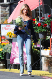 Charlotte McKinney wears Off Shoulder Top & Tight Jeans Buying Flower in Los Angeles