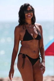Claudia Jordan wears Black Bikini on the Beach in Miami