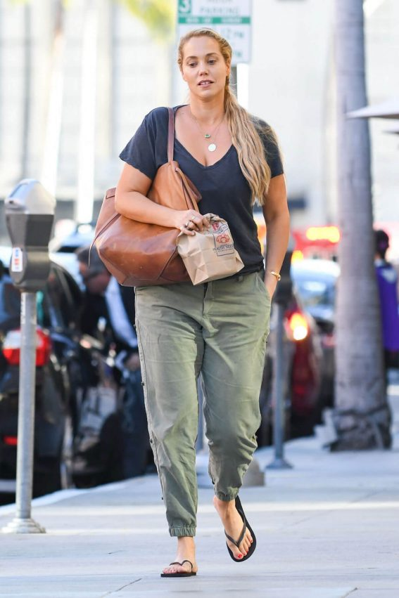 Elizabeth Berkley wears Navy Blue Top & Grey Pants Out and About in Los Angeles