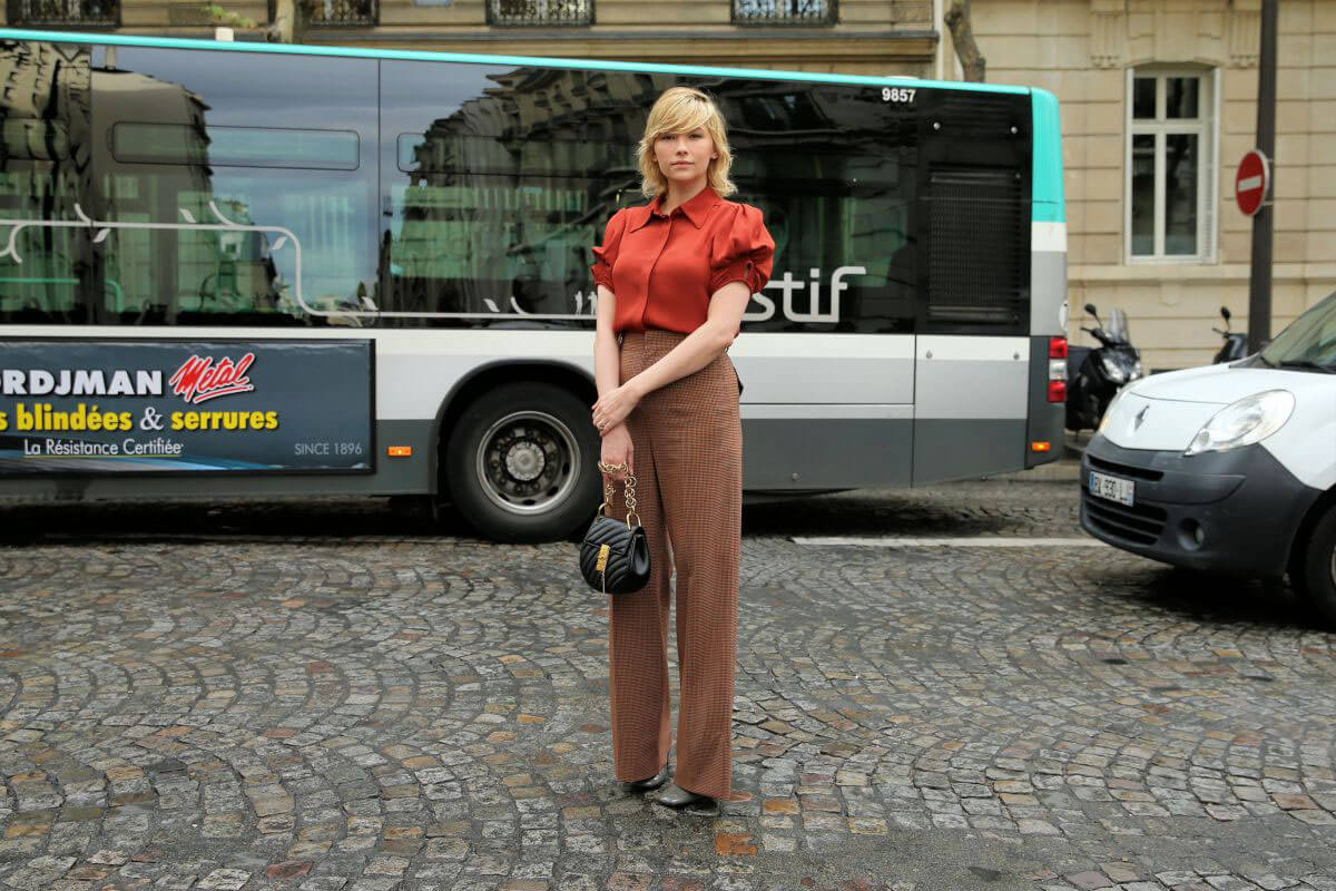 Haley Bennett wears Red Shirt & Brown Bottm at Chloe Fashion Show in Paris