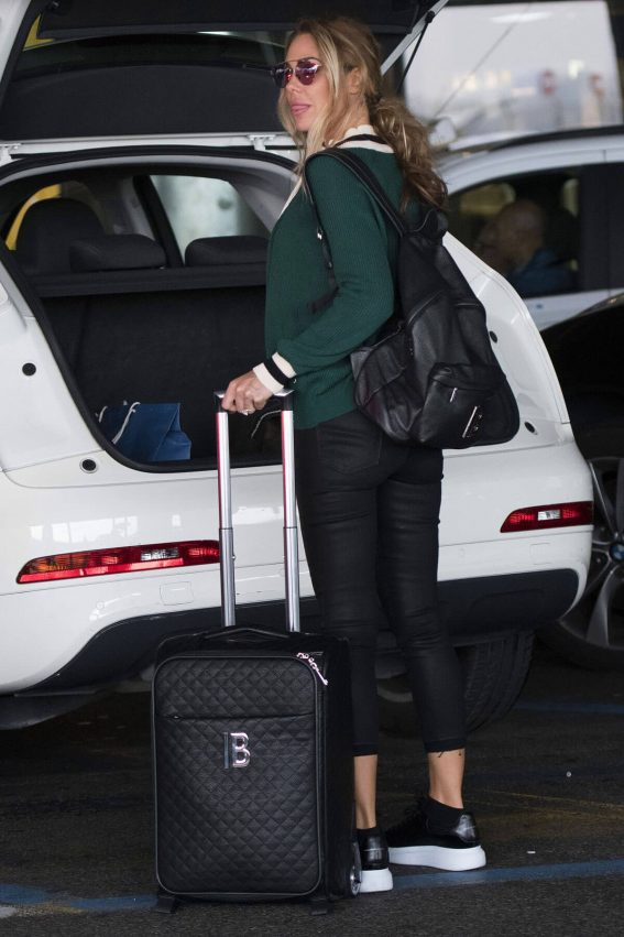 Ilary Blasi wears White Tank Top & Black Jeans at Forlanini Airport in Milan