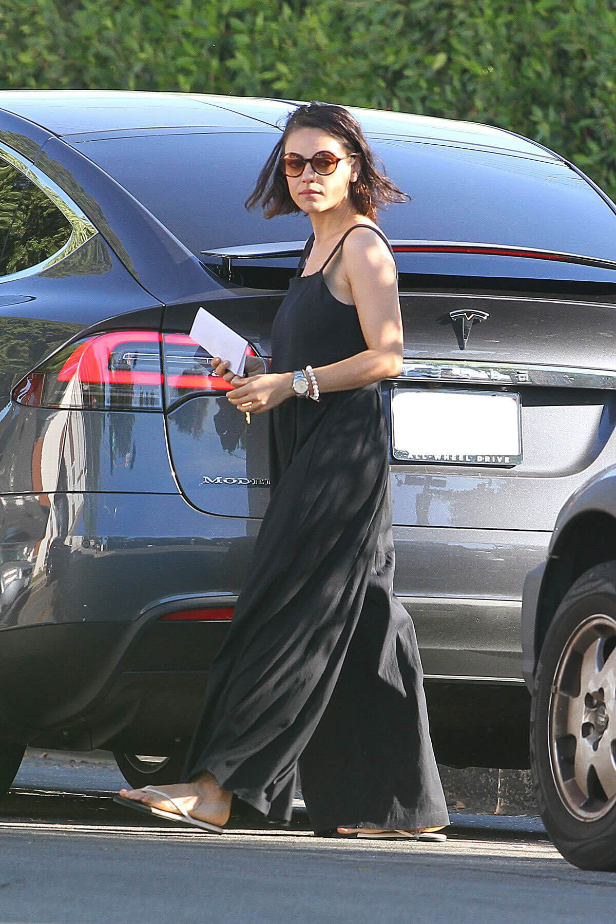 Mila Kunis wears Long Jump Suit Out in Los Angeles