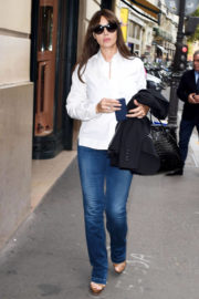 Monica Bellucci wears White Shirt & Blue Jeans Out Shopping in Paris