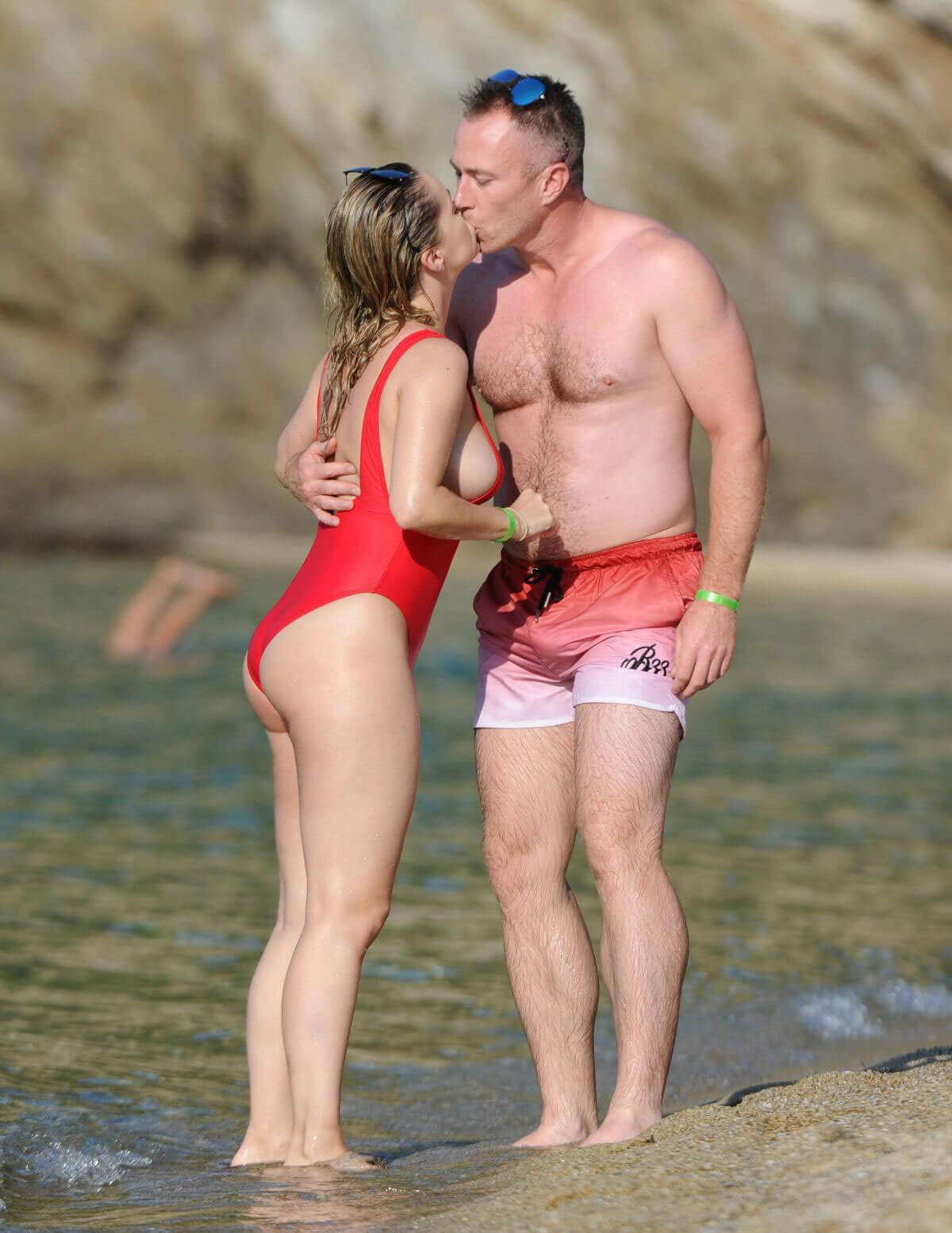 Ola Jordan wears in Red Swimsuit on Vacation in Skiathos