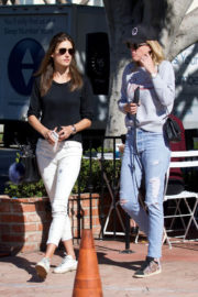 Alessandra Ambrosio wears Black Tee & Ankle Length Jeans Out with Friend in Los Angeles