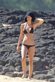 Alexis Ren wears Black Bikini Stills at a Beach in Hawaii