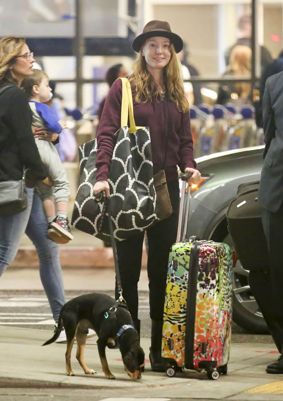 Alicia Witt with her Dog Stills at LAX Airport in Los Angeles