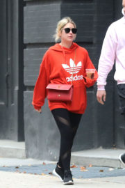 Ashley Benson wears Red Hoodie & Black Tights Out and About in New York