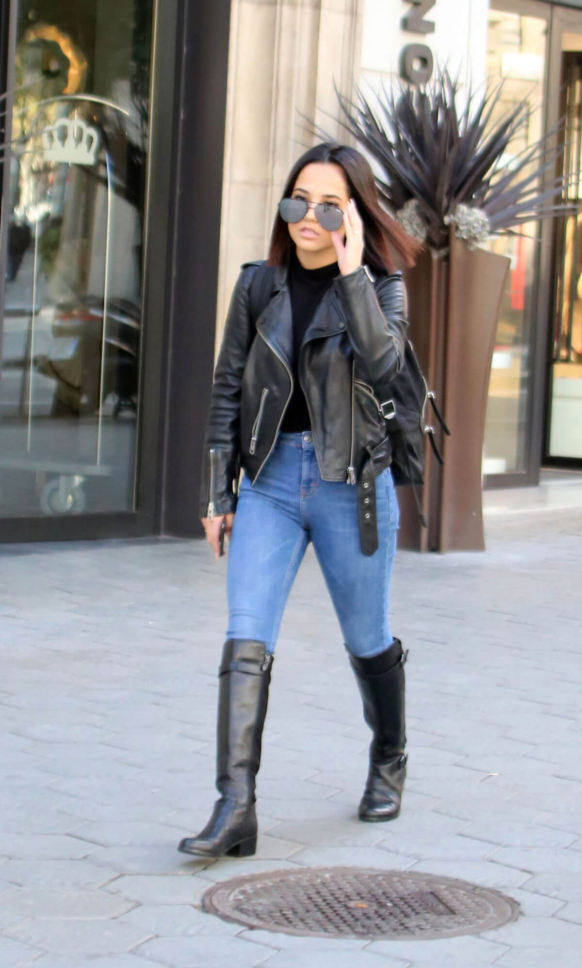 Becky G wears Black Leather Jacket & Blue Jeans Out and About in Barcelona