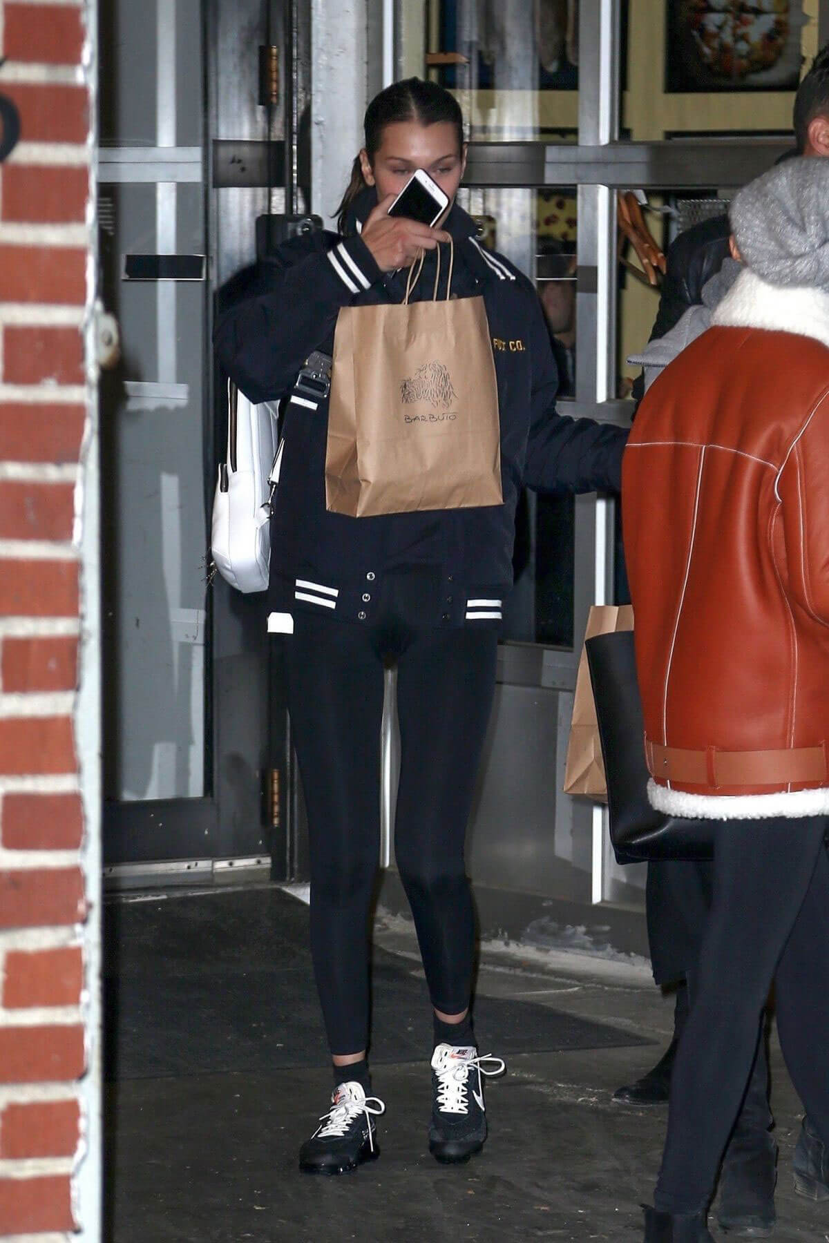 Bella Hadid wears Black Jacket & Tights Leaves Barbuto in New York