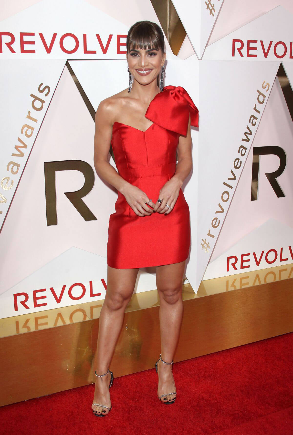 Camila Coelho wears One Shoulder Red Dress at #revolveawards in Hollywood
