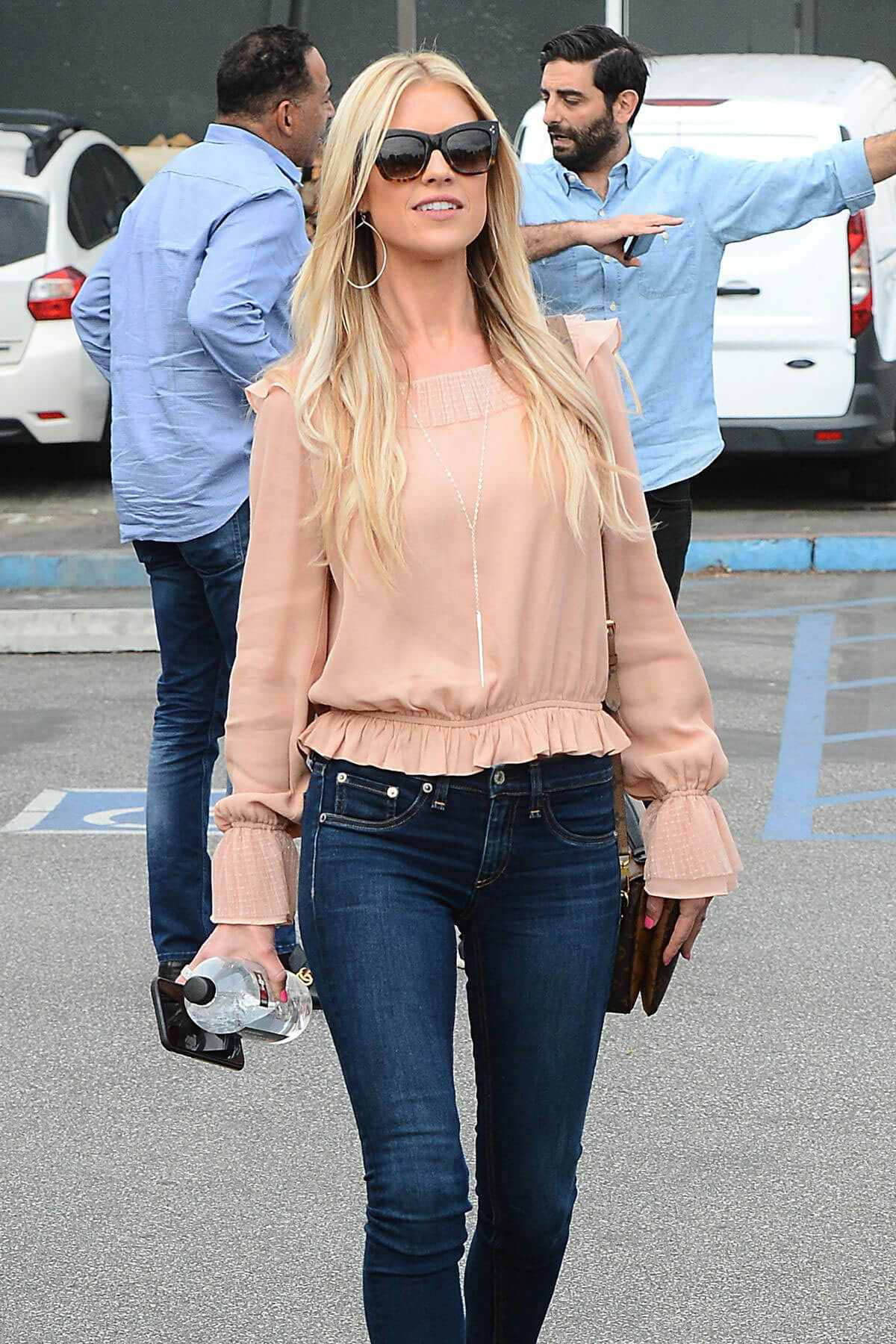 Christina El Moussa wears Dark Blue Jeans Out and About in Brentwood