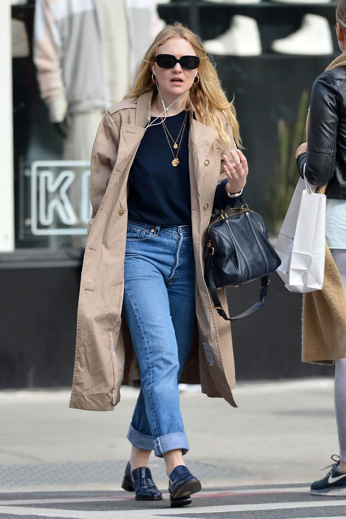 Dakota Fanning wears Long Winter Coat & Blue Jeans Out and About in New York