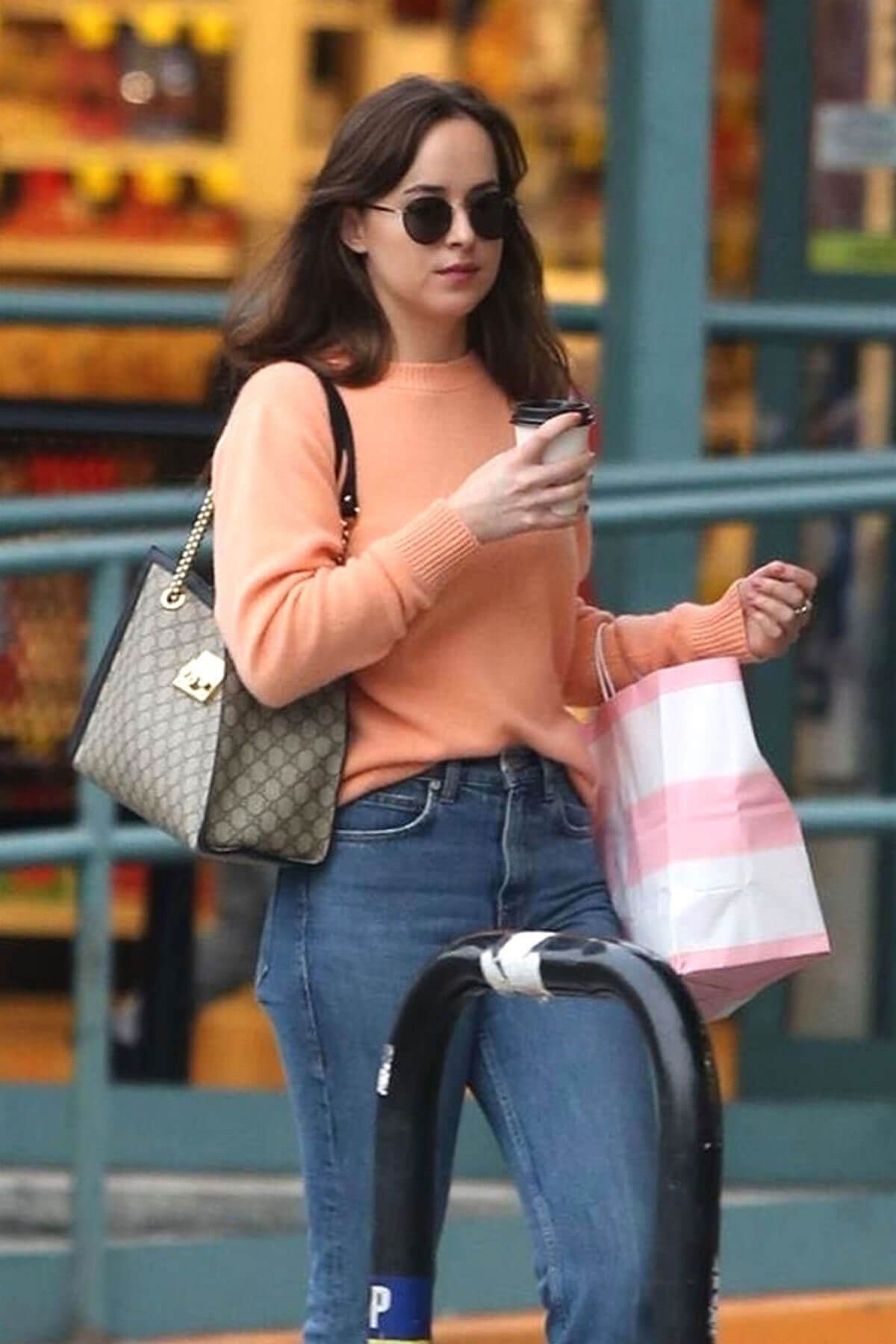 Dakota Johnson wears Peach Sweater Out for Coffee Out in Los Angeles
