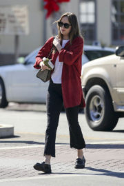 Dakota Johnson wears White Top & Black Ankle Pants Out and About in Los Angeles