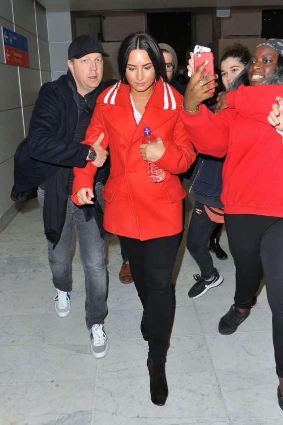 Demi Lovato wears Red Jacket and Black Jeans at Charles De Gaulle Airport in Paris