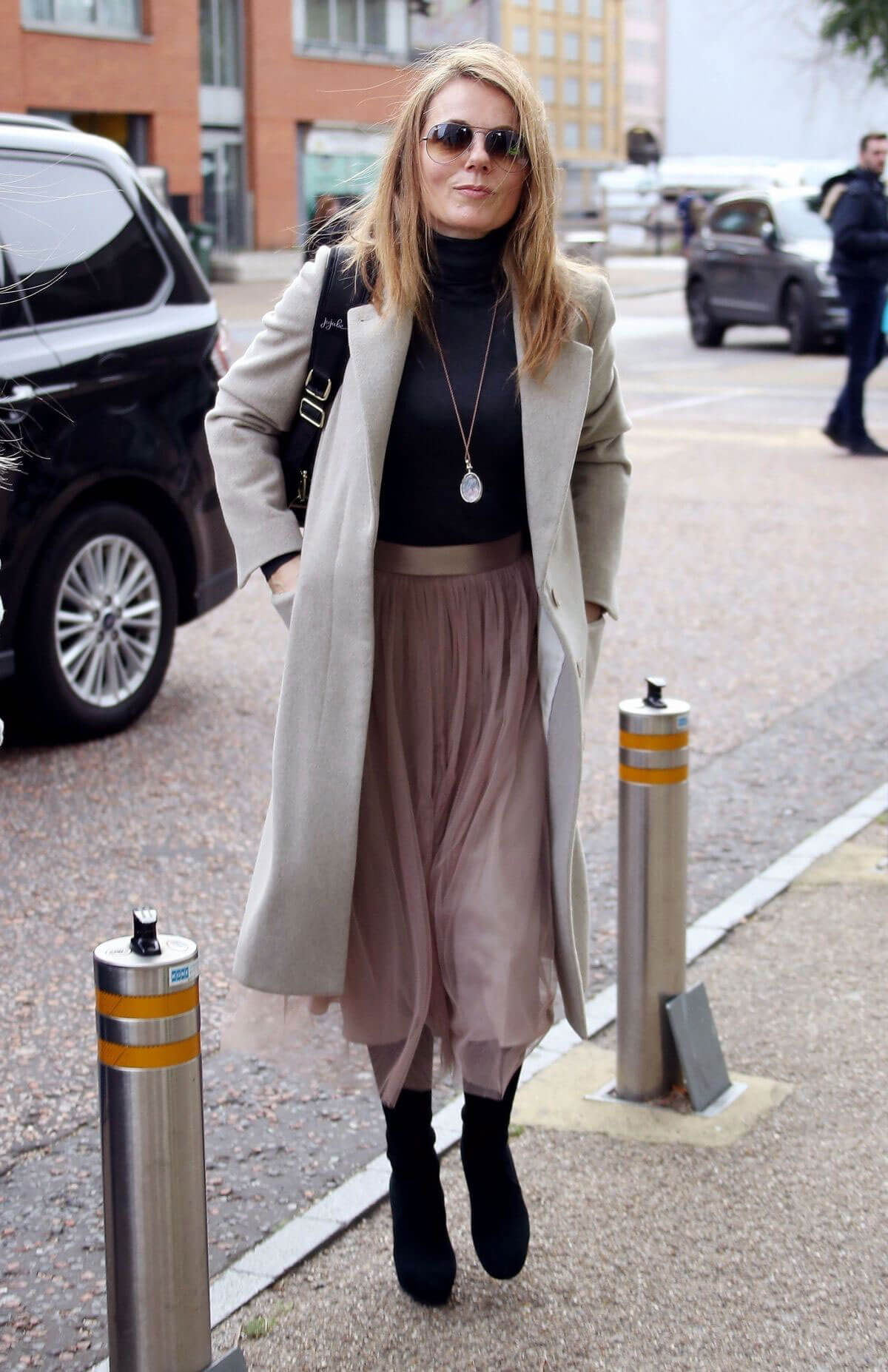 Geri Horner wears Long Winter Coat Leaves ITV Studios in London