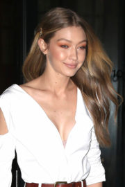 Gigi Hadid shows off legs in White Dress Leaves Her Apartment in New York