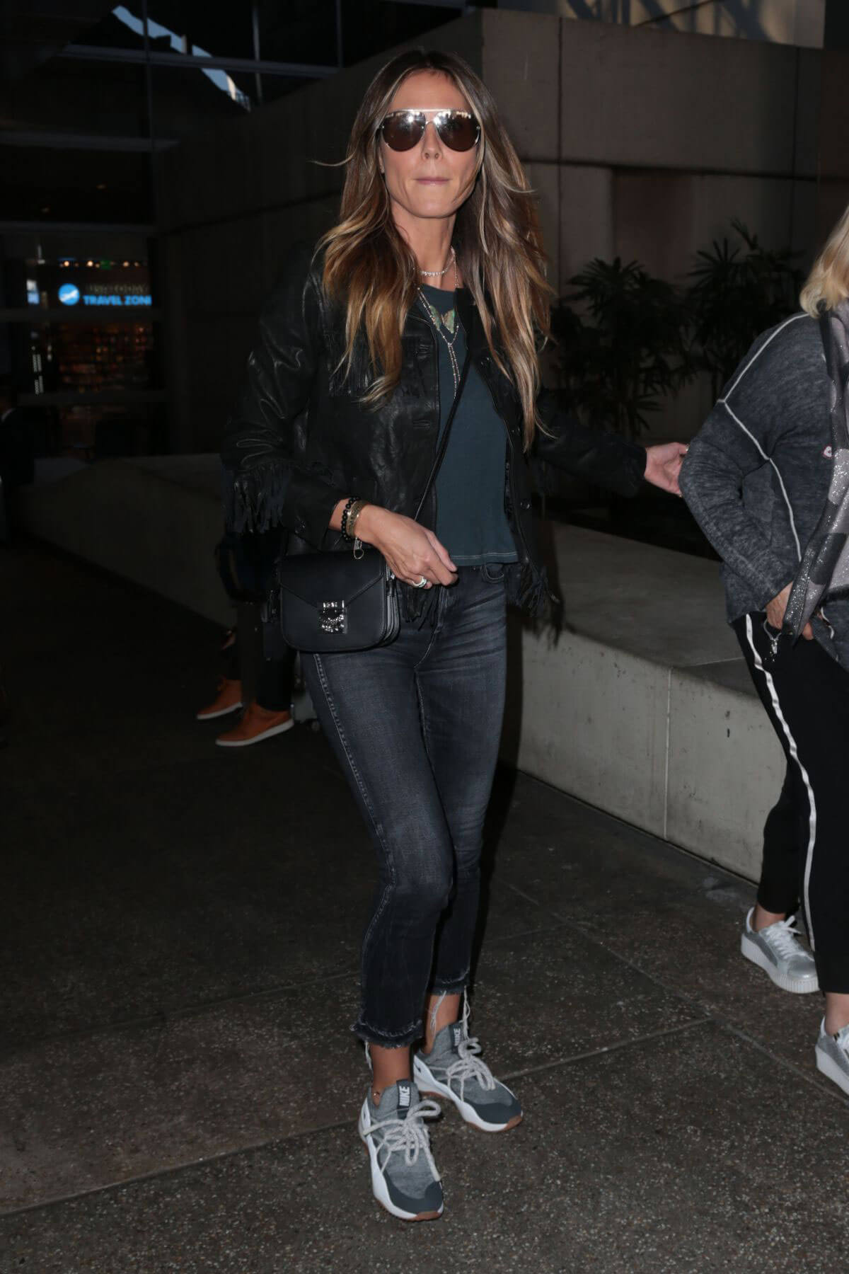 Heidi Klum wears Ankle Length Jeans at LAX Airport in Los Angeles