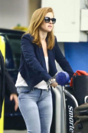 Isla Fisher wears Navy Blue Jacket & Light Blue Jeans Stills at Airport in Miami