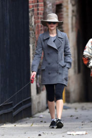 Jennifer Lawrence in Winter Long Jacket & Short Tights Walks Her Dog Out in New York