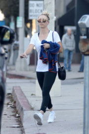 Kaley Cuoco wears White Top & Tights Leaves Yoga Class in Los Angeles