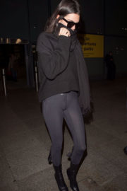 Kendall Jenner in Black Tights at Heathrow Airport in London